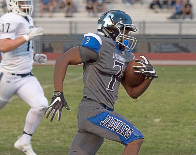 Desert Pines High School's Isaiah Morris (7) runs the ball upfield to score a touchdown during a football game against Centennial high School at Desert Pines High School in Las Vegas, Friday, Aug. ...