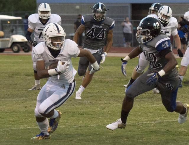 Centennial High School's Bryce Hampton (1) runs the ball upfield during a football game at Desert Pines High School in Las Vegas, Friday, Aug. 26, 2016. Jason Ogulnik/Las Vegas Review-Journal