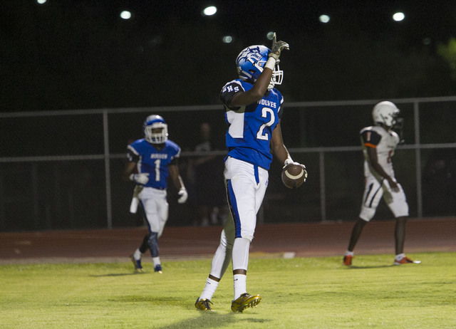 Basicճ De'shawn Eagles (2) celebrates after scoring a touchdown against Chaparral players during a varsity football game at Basic High School in Henderson on Friday, Sept. 2, 2016. Richard B ...