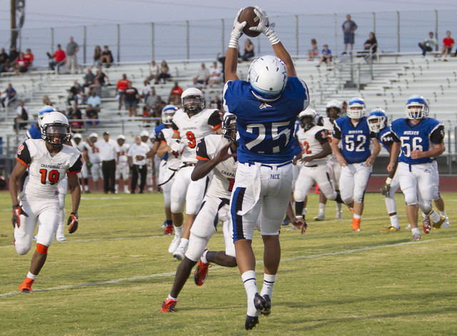 Basic's Jordan Gallegos (25) catches the ball for a touchdown against Chaparral players during a varsity football game at Basic High School in Henderson on Friday, Sept. 2, 2016. Richard Br ...