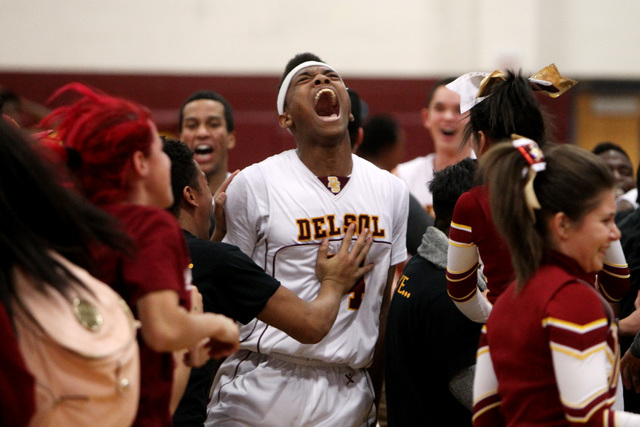 Del Sol forward Brian Greer celebrates a 61-58 victory over Chaparral on Friday. Greer had 23 points and 10 rebounds, and converted a go-ahead three-point play in the final minute for the Dragons. ...