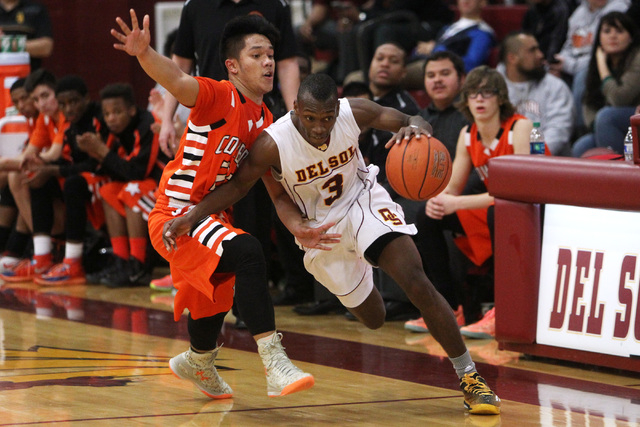 Del Sol guard Rashaun Lawson dribbles around Chaparral guard Robin Rosales on Friday. Lawson scored 10 of his 12 points in the fourth quarter as Del Sol won 61-58. (Sam Morris/Las Vegas Review-Jou ...