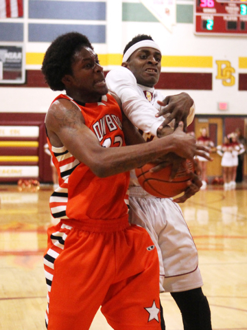 Chaparral center Maharie Trotter, left, and Del Sol forward Noah Spearman fight for a rebound on Friday. Del Sol won 61-58. (Sam Morris/Las Vegas Review-Journal)