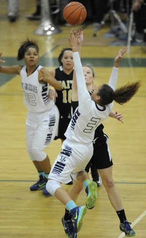 Spring Valley guard Essence Booker (3) goes up for a layup against Faith Lutheran's Morgan Hill in the first quarter of the Division I-A Southern Region girls basketball championship game at Sprin ...