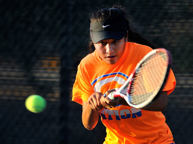 Bishop Gorman's Amber Del Rosario eyes the ball during her Sunset Region singles championship match against Palo Verde's Annie Walker on Monday. (David Becker/Las Vegas Review-Journal)