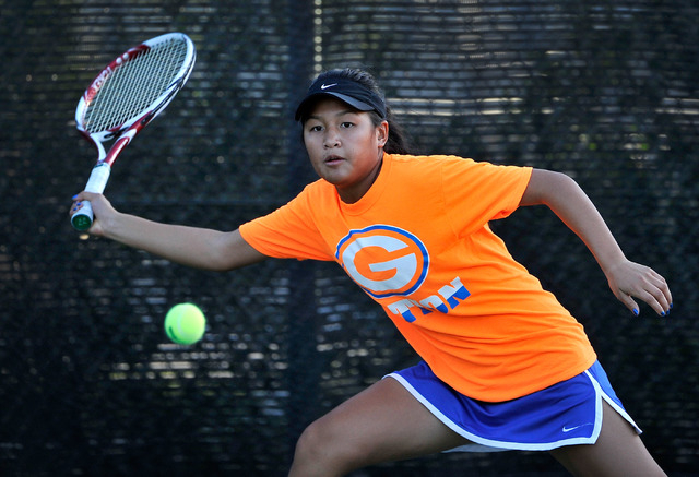 Bishop Gorman's Amber Del Rosario goes for a forehand during the Sunset Region girls singles final on Monday. (David Becker/Las Vegas Review-Journal)