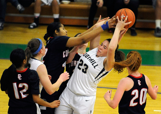 Foothill's Indoneisha Struve (23) grabs a rebound against Coronado's Samantha Green during Thursday's Sunrise Region semifinal at Green Valley. Foothill won 66-50. (David Becker/Las Vegas Review-J ...
