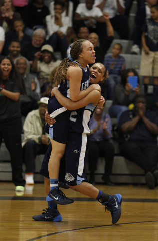 Centennial's Teirra Hicks lifts teammate Tramina Jordan in celebration after the Bulldogs defeated Bishop Gorman 66-59 in the Sunset Region championship game on Friday at Durango. Jordan had 15 po ...