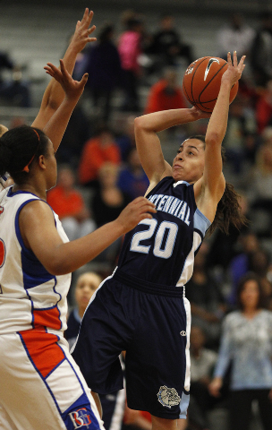 Centennial's Simone Barber goes up for a shot against Bishop Gorman in the Sunset Region championship game at Durango on Friday. Barber scored 11 to help the Bulldogs to a 66-59 victory. (John Loc ...