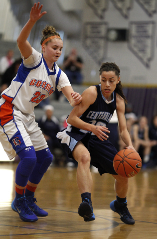Centennial's Simone Barber drives against Bishop Gorman's Megan Jacobs on Friday at Durango. Barber had 11 points to help the Bulldogs to a 66-59 win for the Sunset Region championship. (John Loch ...
