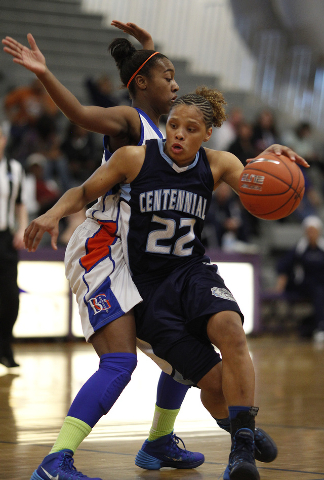 Centennial's Teirra Hicks drives by Bishop Gorman's Maddison Washington on Friday. Hicks had 11 points and seven rebounds in a 66-59 win in the Sunset Region title game at Durango. (John Locher/La ...