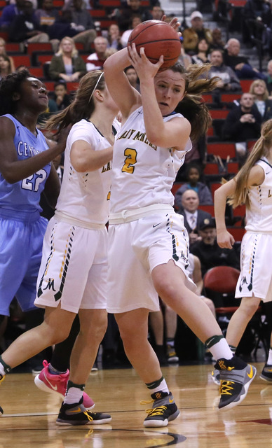 Bishop Manogue's Maddie Camacho (2) recovers a rebound during the first half of a Class 4A girls state final game at the Cox Pavillion on Friday, Feb. 24, 2017, in Las Vegas. (Christian K. Lee/Las ...