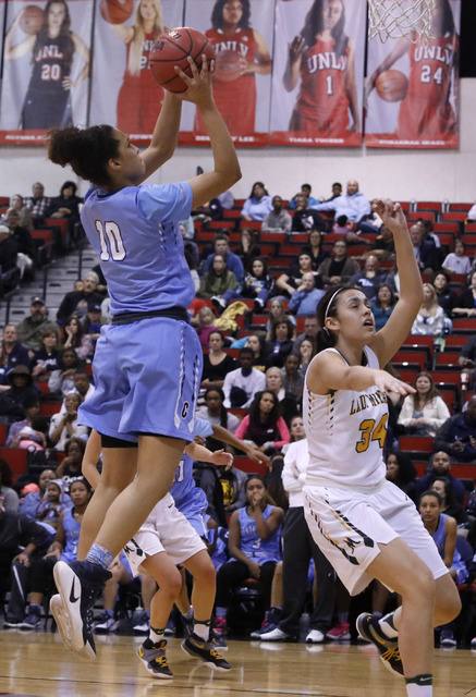 Centennial's Jayden Eggleston (10) shoots over Bishop Manogue's Julia McElwee (34) during the second half of a Class 4A girls state final game at the Cox Pavillion on Friday, Feb. 24, 2017, in Las ...