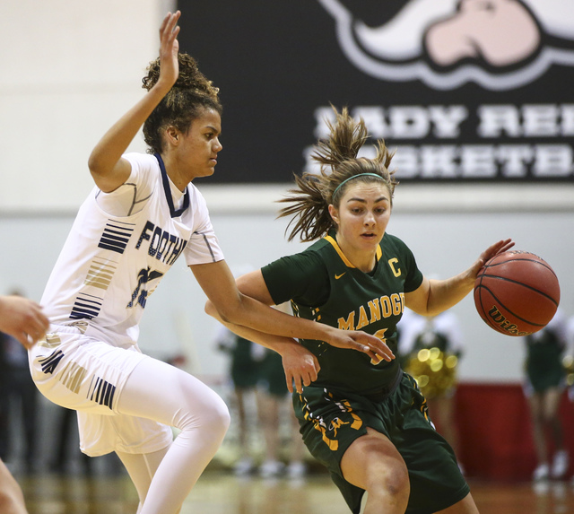 Bishop Manogue guard Malia Holt (5) drives against Foothill's Rae Burrell (12) during the Class 4A girls state basketball semifinals at the Cox Pavilion in Las Vegas on Thursday, Feb. 23, 2017. Bi ...