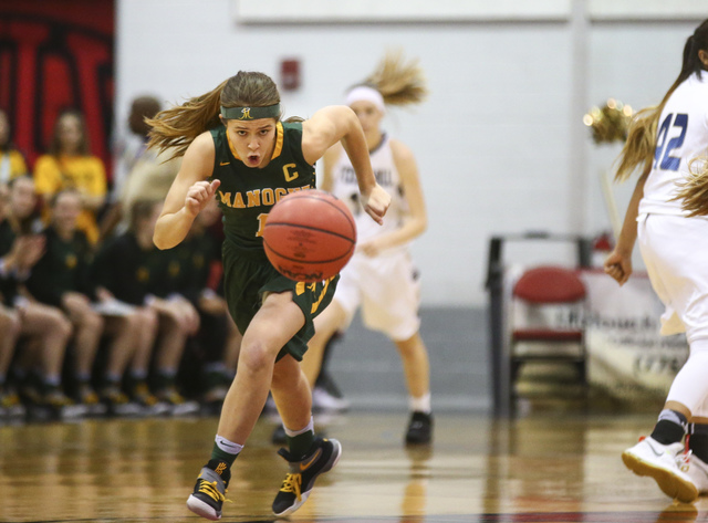 Bishop Manogue guard Katie Turner (1) drives the ball against Foothill during the Class 4A girls state basketball semifinals at the Cox Pavilion in Las Vegas on Thursday, Feb. 23, 2017. Bishop Man ...