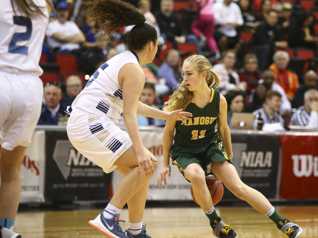 Bishop Manogue guard Kenna Holt (11) drives against Foothill's Bri Rosales (15) during the Class 4A girls state basketball semifinals at the Cox Pavilion in Las Vegas on Thursday, Feb. 23, 2017. B ...