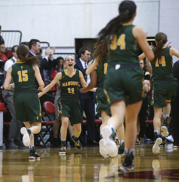 Bishop Manogue players react after defeating Foothill 74-37 in the Class 4A girls state basketball semifinals at the Cox Pavilion in Las Vegas on Thursday, Feb. 23, 2017. (Chase Stevens/Las Vegas  ...