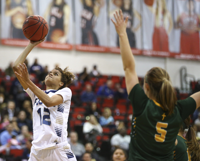 Foothill's Rae Burrell (12) shoots against Bishop Manogue during the Class 4A girls state basketball semifinals at the Cox Pavilion in Las Vegas on Thursday, Feb. 23, 2017. Bishop Manogue won 74-3 ...