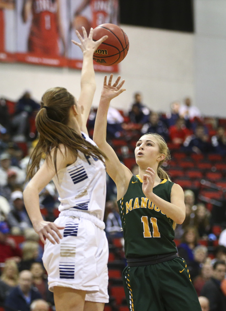 Bishop Manogue guard Kenna Holt (11) shoots over Foothill's Aqui Williams (2) during the Class 4A girls state basketball semifinals at the Cox Pavilion in Las Vegas on Thursday, Feb. 23, 2017. Bis ...