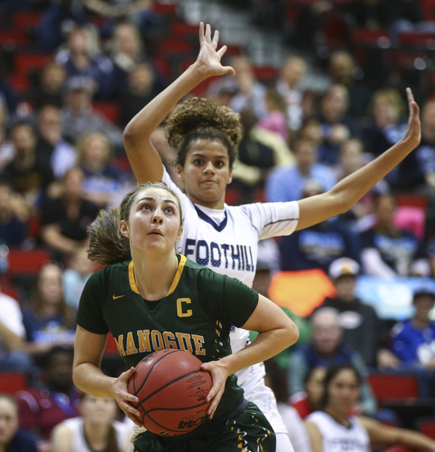 Bishop Manogue guard Malia Holt (5) drives to the basket against Foothill during the Class 4A girls state basketball semifinals at the Cox Pavilion in Las Vegas on Thursday, Feb. 23, 2017. Bishop  ...