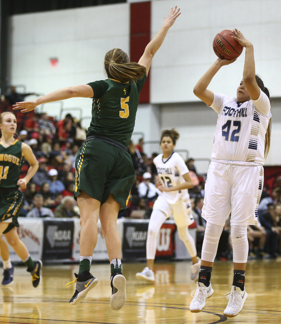 Foothill's Trinity Betoney (42) shoots over Bishop Manogue guard Malia Holt (5) during the Class 4A girls state basketball semifinals at the Cox Pavilion in Las Vegas on Thursday, Feb. 23, 2017. B ...