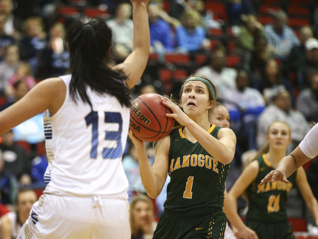 Bishop Manogue guard Katie Turner (1) shoots against Foothill during the Class 4A girls state basketball semifinals at the Cox Pavilion in Las Vegas on Thursday, Feb. 23, 2017. Bishop Manogue won  ...