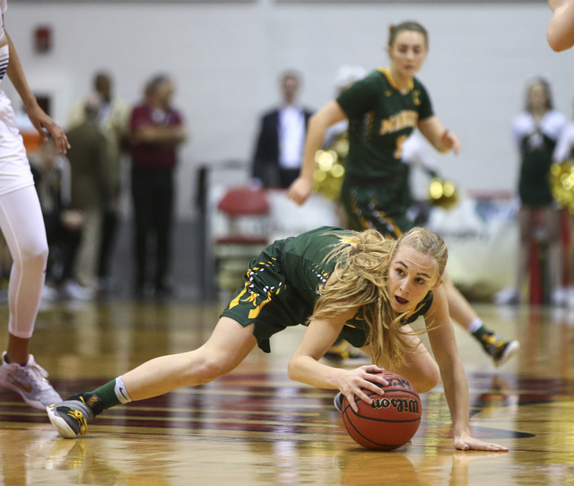 Bishop Manogue guard Kenna Holt (11) reaches out to keep control of the ball during the Class 4A girls state basketball semifinals against Foothill at the Cox Pavilion in Las Vegas on Thursday, Fe ...