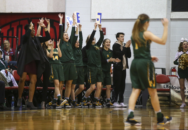 Bishop Manogue players cheer as they play Foothill during the Class 4A girls state basketball semifinals at the Cox Pavilion in Las Vegas on Thursday, Feb. 23, 2017. Bishop Manogue won 74-37. (Cha ...