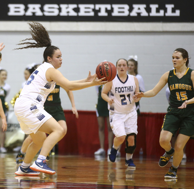 Foothill's Bri Rosales (15) reels in a pass while playing Bishop Manogue during the Class 4A girls state basketball semifinals at the Cox Pavilion in Las Vegas on Thursday, Feb. 23, 2017. Bishop M ...