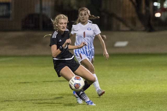 Alexis Lloyd (8) from Palo Verde School battles for the ball against Jaden Terrana (1) from Bishop Gorman High School during the Sunset Region girls soccer semifinal game at Bettye Wilson Soccer C ...
