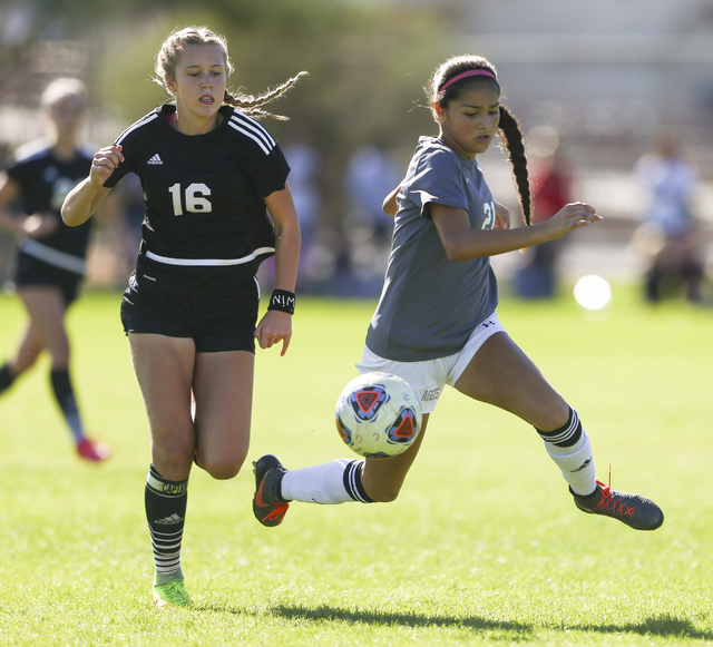 Palo Verde's Macee Barlow (16) and Arbor View's 	Karissa Martinez (21) fight for the ball during the Sunset Region girls soccer championship game at Bettye Wilson Soccer Complex in Las Vegas on Sa ...