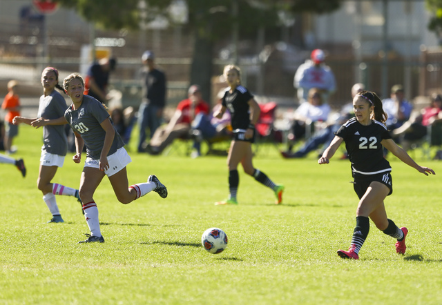 Palo Verde's Sloan Nelson (22) maintains control of the ball during the Sunset Region girls soccer championship game at Bettye Wilson Soccer Complex in Las Vegas on Saturday, Nov. 5, 2016. Palo Ve ...