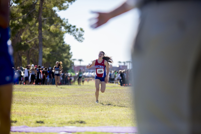 Kyra Hunsberger, Reno, encloses on the finish line of the 3.1 mile in the 2016 NIAA Nevada State High School Cross Country Championships, taking 7th place with a time of 18:51.2 at Craig Ranch in  ...