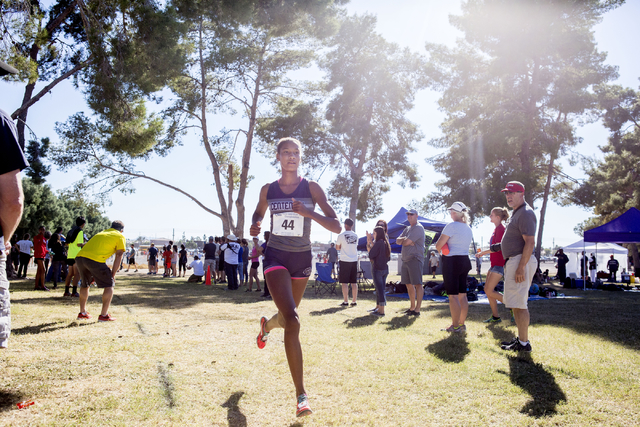 Centennial junior Alexis Gourrier leads the pack of runners   on the second lap of the 3.1 mile in the 2016 NIAA Nevada State High School Cross Country Championships, at Craig Ranch in Las Vegas S ...