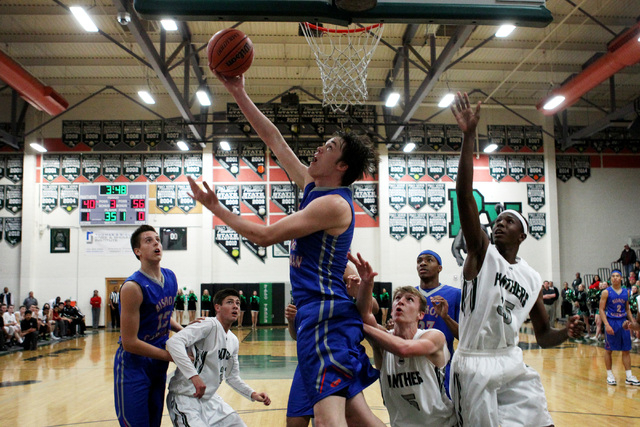 Bishop Gorman center Stephen Zimmerman lays in two points against Palo Verde Thursday. Zimmerman had 16 points, five rebounds and six assists in an 88-63 Gorman win. Zimmerman was Southwest League ...