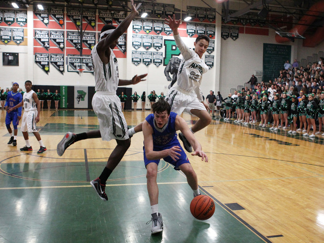 Bishop Gorman center Stephen Zimmerman fakes out Palo Verde's Jamell Garcia-Williams, left, and Taylor Miller on Thursday. Zimmerman had 16 points as Gorman won, 88-63. (Sam Morris/Las Vegas Revie ...