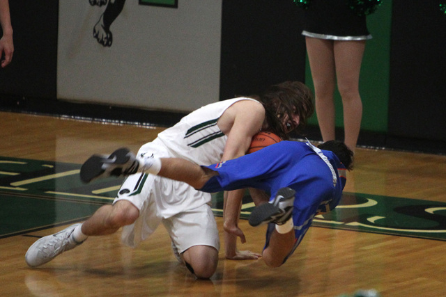 Palo Verde's Connor Black throws Bishop Gorman guard Michael Delmont over his shoulder during a held ball situation in the second half of their game Thursday, Jan. 8, 2015, at Palo Verde. Bishop G ...