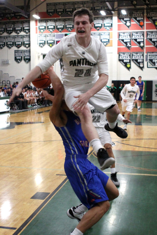Palo Verde's Ryan Vogelei fouls Bishop Gorman guard Richie Thornton on Thursday. Gorman won the game 88-63. (Sam Morris/Las Vegas Review-Journal)