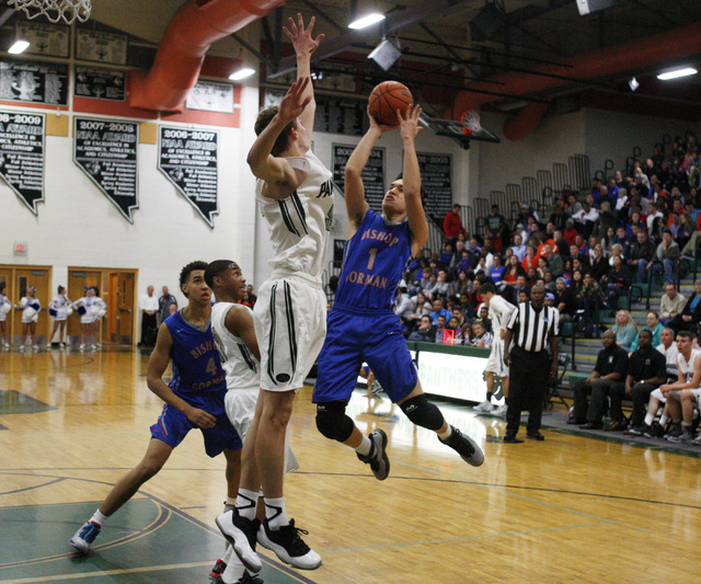 Bishop Gorman guard Chase Noma'aea is defended by Palo Verde forward Grant Dressler on Thursday. Gorman won the game 88-63. (Sam Morris/Las Vegas Review-Journal)