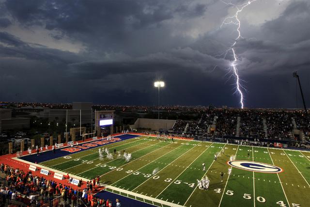 Lightning strikes over the Las Vegas valley as Bishop Gorman prepares to take on St. John Bosco Friday, Sept. 26, 2014 at Bishop Gorman. (Sam Morris/Las Vegas Review-Journal)