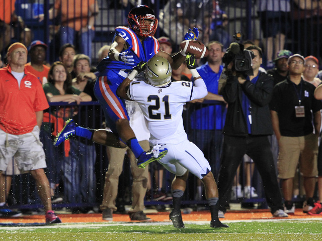 Bishop Gorman wide receiver Cordell Broadus has a pass broken up by St. John Bosco defensive back Mykal Tolliver during their game Friday. Broadus caught four passes for 64 yards in the Gaels' 34- ...