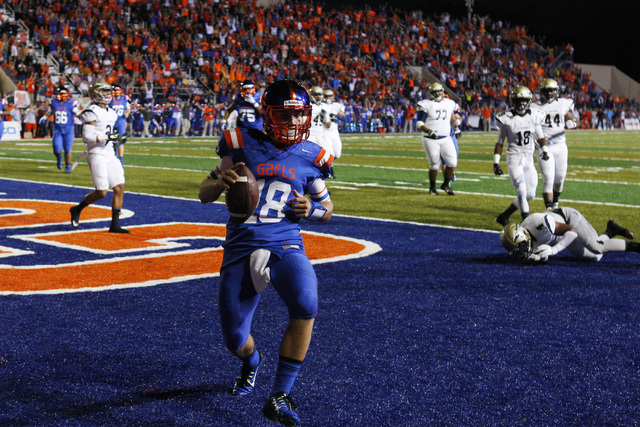 Bishop Gorman quarterback Tate Martell slips into the end zone past the St. John Bosco defense during their game Friday, Sept. 26, 2014 at Bishop Gorman. Martell also threw for two touchdowns in t ...