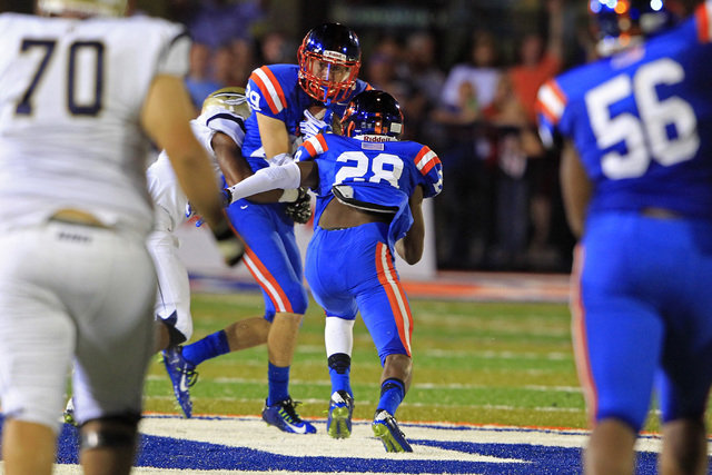 Bishop Gorman safety Bryce Garcia pulls in an interception against St. John Bosco during their game Friday, Sept. 26, 2014 at Bishop Gorman. Gorman won 34-31. (Sam Morris/Las Vegas Review-Journal)