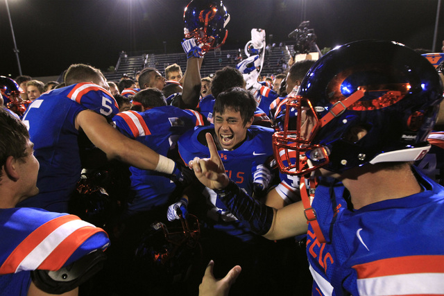 Bishop Gorman celebrate knocking off St. John Bosco, 34-31 at Bishop Gorman on Friday. The Gaels built a 27-3 before holding off a late rally by the Braves. (Sam Morris/Las Vegas Review-Journal)