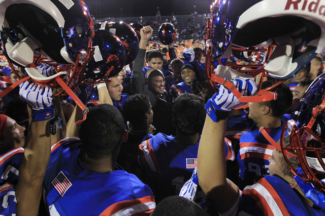 Bishop Gorman coach Tony Sanchez and his players celebrate defeating St. John Bosco, 34-31 on Friday. (Sam Morris/Las Vegas Review-Journal)