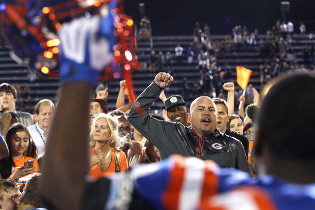 Bishop Gorman coach Tony Sanchez and his players celebrate defeating St. John Bosco, 34-31, on Friday. The Gaels entered the game ranked No. 2 nationally by USA Today. Bosco was ranked No. 1. (Sam ...