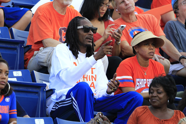 Snoop Dogg watches Bishop Gorman and St. John Bosco during their game Friday. The entertainer's son, Cordell Broadus, caught four passes for 64 yards as Gorman won the game 34-31. (Sam Morris/Las  ...