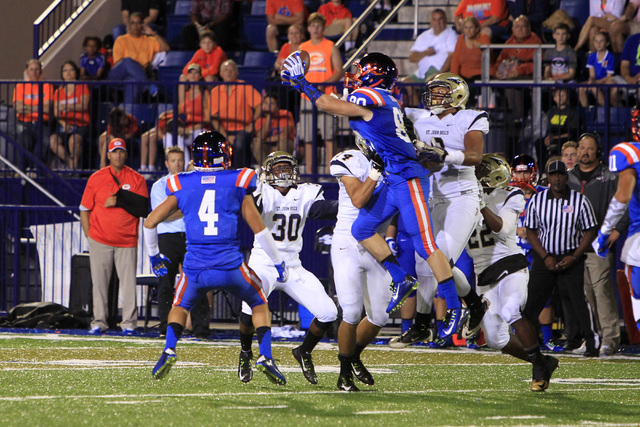 Bishop Gorman Karl Regan grabs and drops an onside kick by St. John Bosco during their game Friday, Sept. 26, 2014 at Bishop Gorman. Gorman recovered the ball and went on the win the game 34-31. ( ...