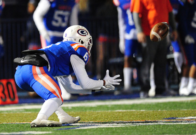 Bishop Gorman safety Austin Arnold catches a flea-flicker pass for a first down against Faith Lutheran in the first half of their prep football game at Bishop Gorman High School in Las Vegas Frida ...