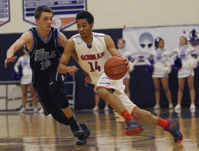 Bishop Gorman senior point guard Noah Robotham (14) drives against Foothill's Vincent Modugno (10) earlier this season. Robotham was the Southwest League MVP. (Jason Bean/Las Vegas Review-Journal)